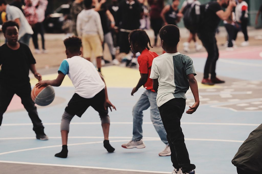 Young boys playing basketball at a school in Watts, CA.